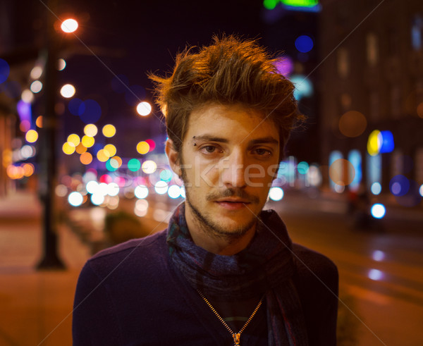 Young handsome man on the night city street Stock photo © zurijeta