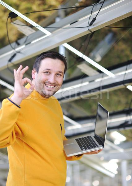 Engineer using laptop at factory Stock photo © zurijeta