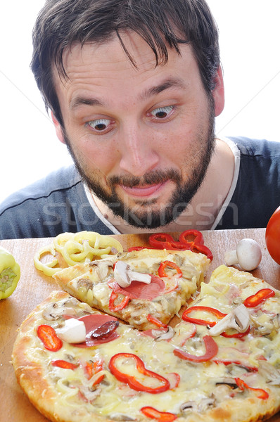 Adult person with surprised face on pizza table Stock photo © zurijeta