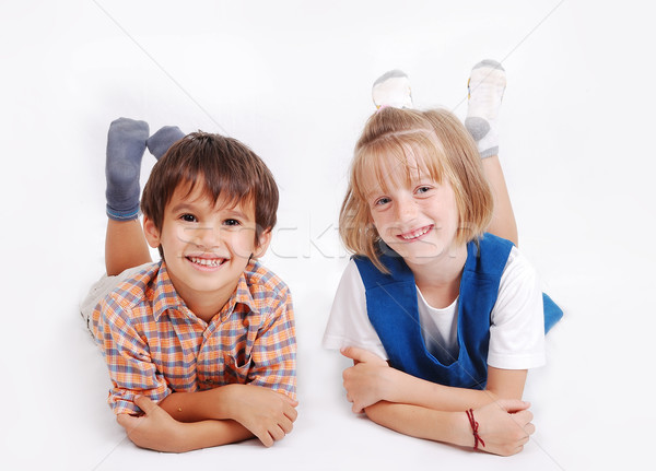 Two male and female mates laying down isolated Stock photo © zurijeta