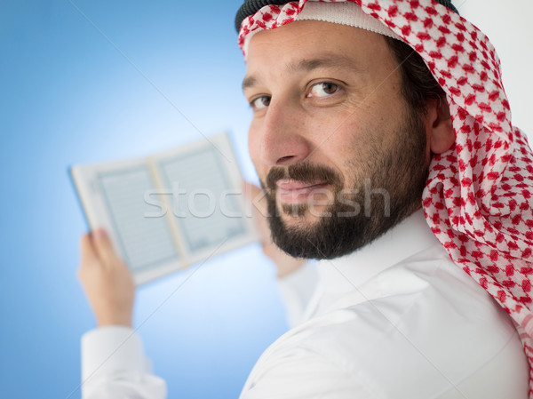 Arabskie człowiek modląc uśmiech książki Zdjęcia stock © zurijeta