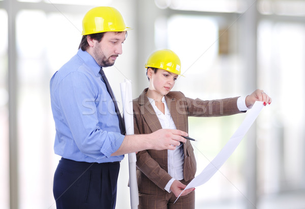 Man and woman architects on a building construction site Stock photo © zurijeta