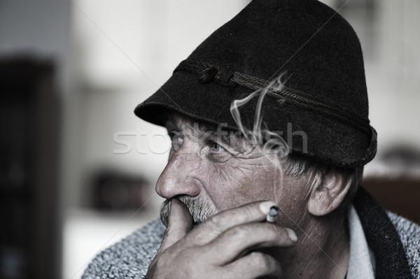 Closeup Artistic Photo of Aged Man With  Grey Mustache Smoking Cigarette, grain added Stock photo © zurijeta