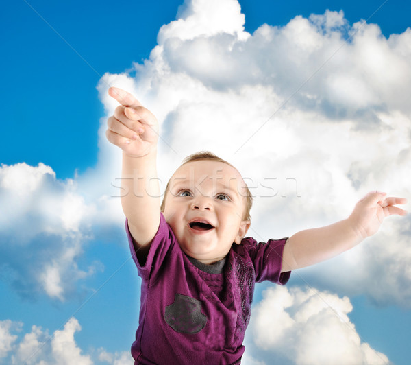 Llittle cute baby wants to fly into sky Stock photo © zurijeta