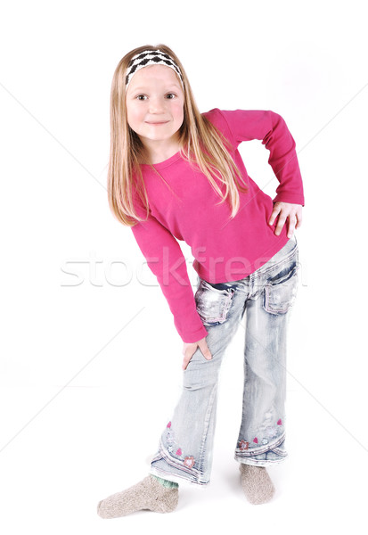 Cute little girl standing in studio Stock photo © zurijeta