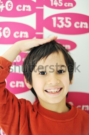 Cute kid measuring his height Stock photo © zurijeta