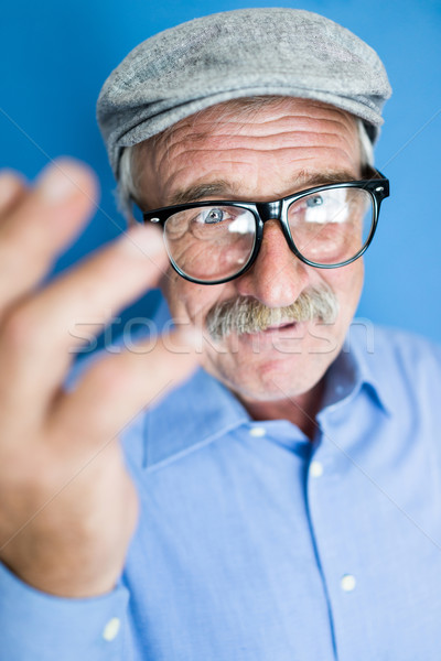 Portrait of a smiling and confident senior man with mustache, wr Stock photo © zurijeta