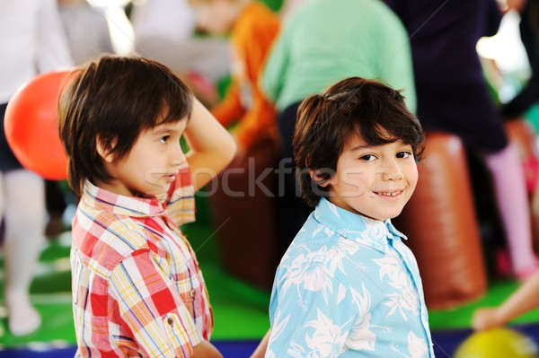Kids playing on colorful kindergarden playground Stock photo © zurijeta