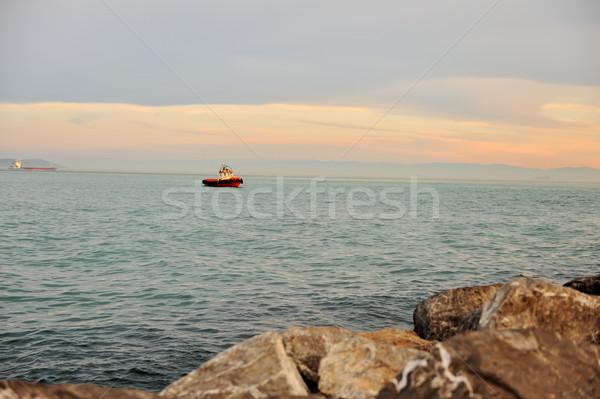 Mar barco agua nubes paisaje luz Foto stock © zurijeta