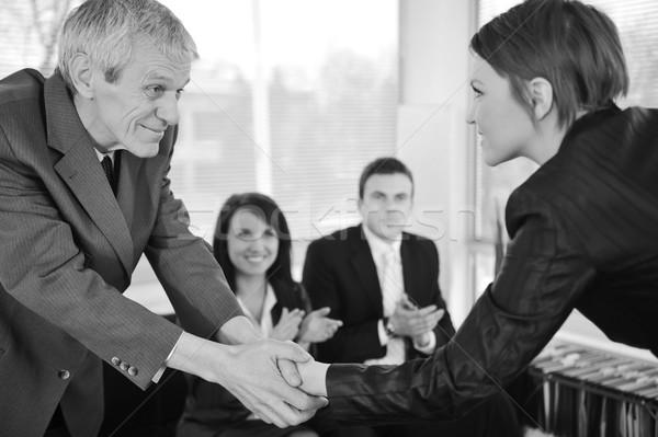 Jovem mulher de negócios entrevista de emprego aperto de mãos patrão negócio Foto stock © zurijeta