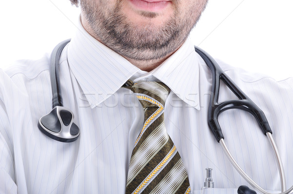 Young attractive male doctor in characteristic clothes Stock photo © zurijeta