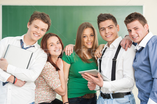 Five smiling modern students Stock photo © zurijeta