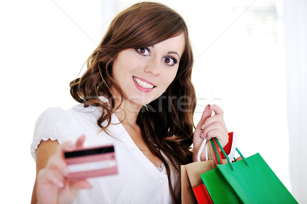 Shopping woman showing business card looking at camera Stock photo © zurijeta