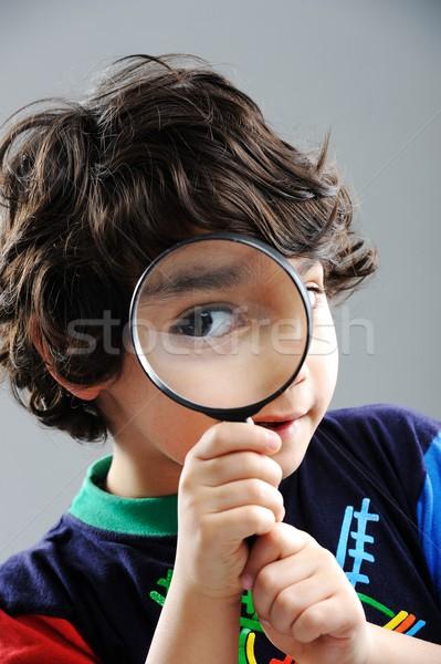 Foto stock: Retrato · nino · mirando · lupa · sonrisa · escuela