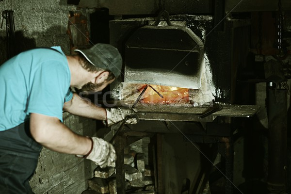 Iron casting process with high temperature fire in old metal par Stock photo © zurijeta
