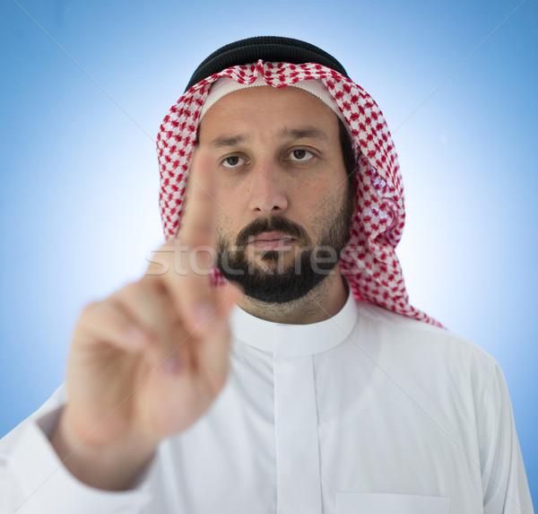 Arabski człowiek wskazując palec działalności strony Zdjęcia stock © zurijeta