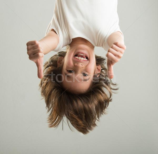 Little boy hanging upside down Stock photo © zurijeta