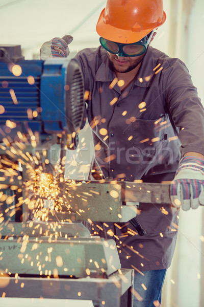 Stock photo: Worker welding in industrial background at factory