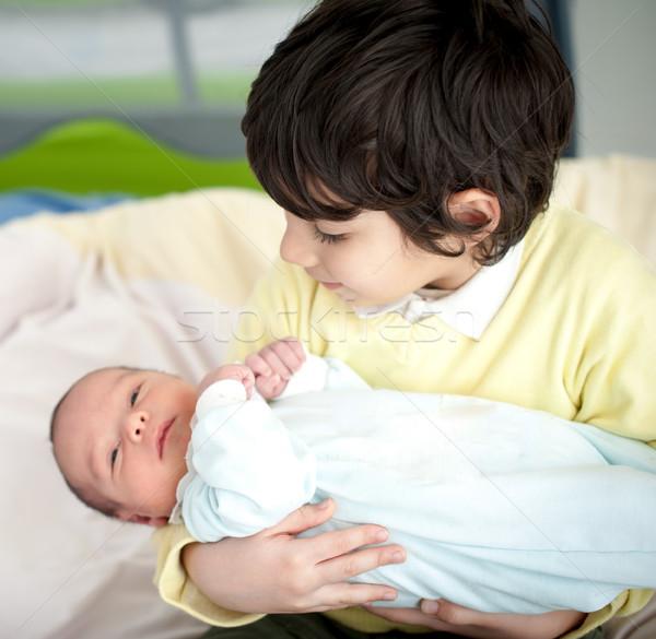 Newborn baby with bigger brother Stock photo © zurijeta