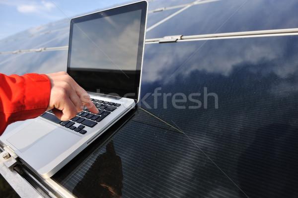 Pressing enter button on laptop at  photovoltaic solar panels Stock photo © zurijeta