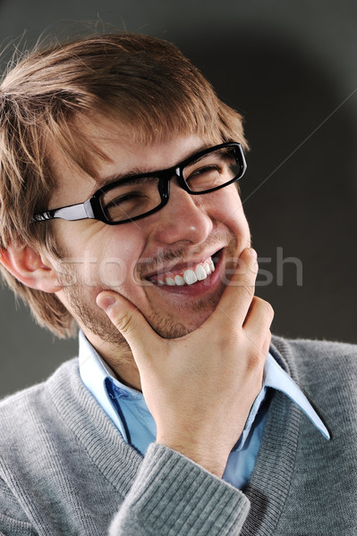 Young caucasian man with glasses laughing Stock photo © zurijeta