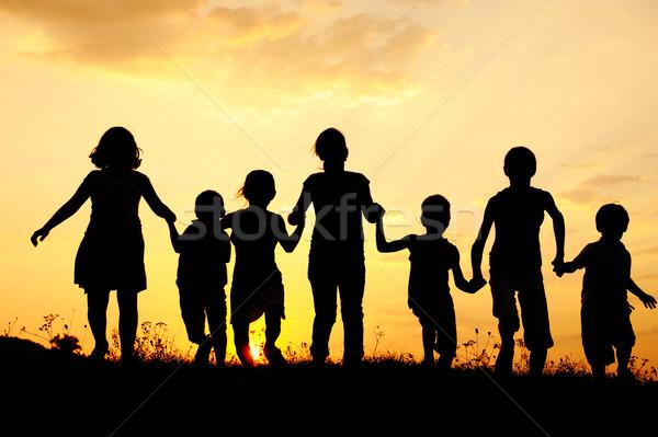 Children running on meadow at sunset Stock photo © zurijeta