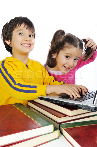 Children playing on laptop put on books Stock photo © zurijeta