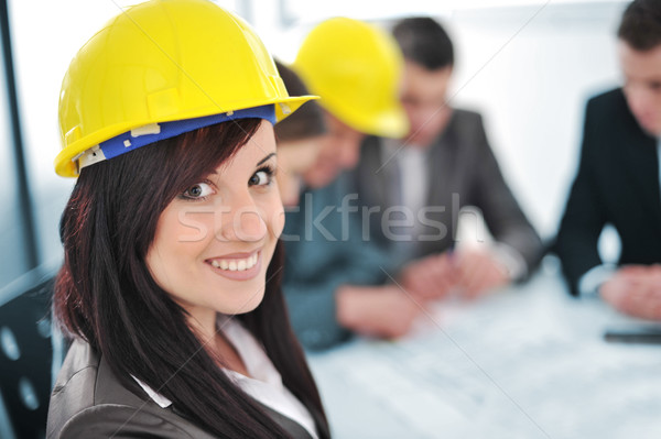 Business people in office wearing hard hat Stock photo © zurijeta