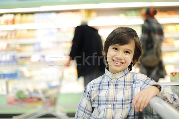 Boy in supermarket Stock photo © zurijeta