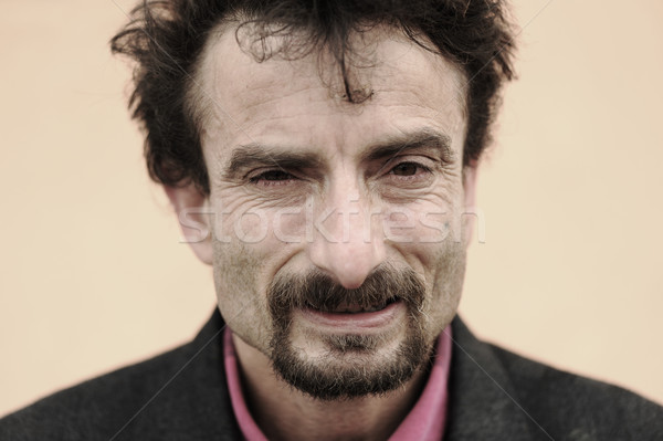 portrait of rough face man, gipsy Stock photo © zurijeta