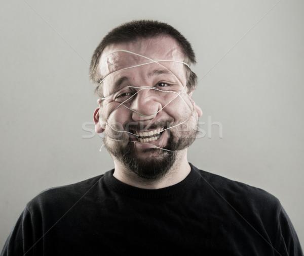 Lelijk man portret glimlach gezicht ogen Stockfoto © zurijeta