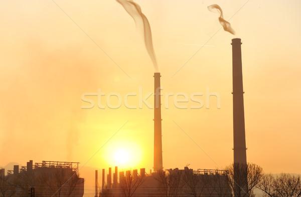 Sanayi büyük baca gün batımı güneş enerji Stok fotoğraf © zurijeta