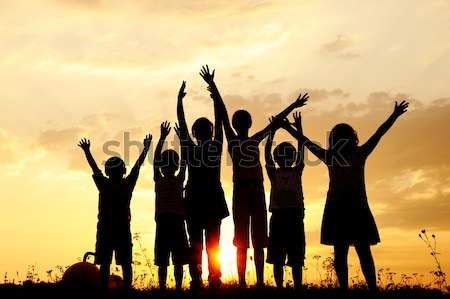 Silhouette, group of happy children playing on meadow, sunset, s Stock photo © zurijeta