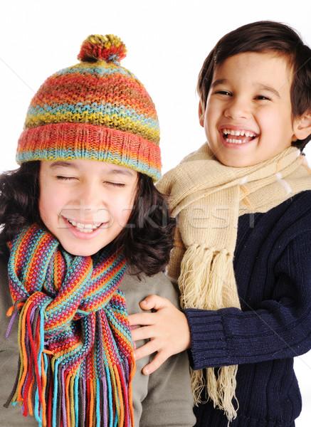 Cute children with winter clothes isolated in studio Stock photo © zurijeta