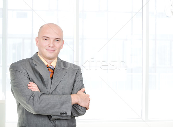 Attractive serious businessman with folded arms, balded head Stock photo © zurijeta