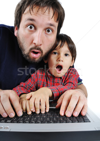 Father and son on laptop, shock  Stock photo © zurijeta
