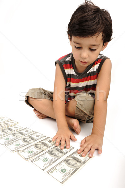 Cute little kid plays with money Stock photo © zurijeta