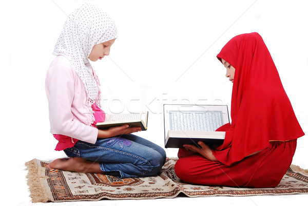 A young muslim girls in traditional clothes reading Koran Stock photo © zurijeta