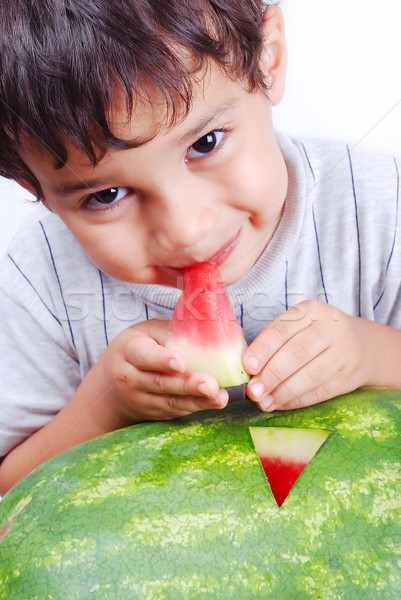 Very cute kid eating watermelon Stock photo © zurijeta