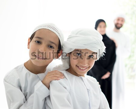 Stock photo: Happy Arabic family having fun time standing in line at home