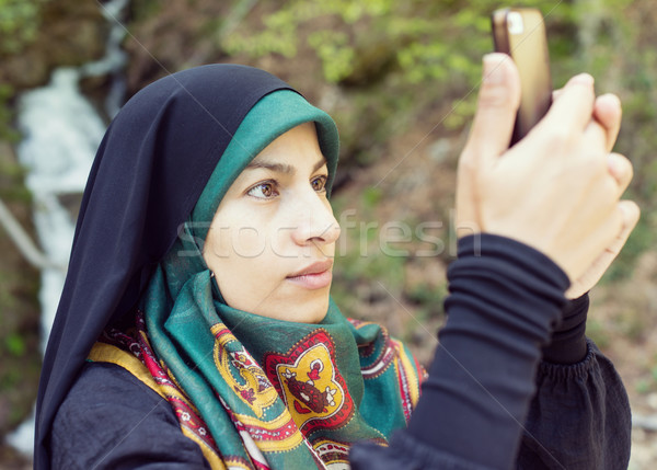 Beautiful Muslim woman in nature Stock photo © zurijeta