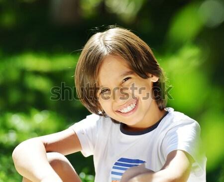 счастливым ребенка зеленая трава мало мальчика сидят Сток-фото © zurijeta