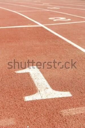 Numbers on running track, one 1 for winner Stock photo © zurijeta