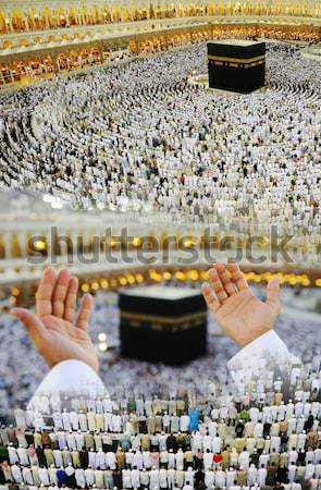 Muslim praying at Mekkah with hands up Stock photo © zurijeta