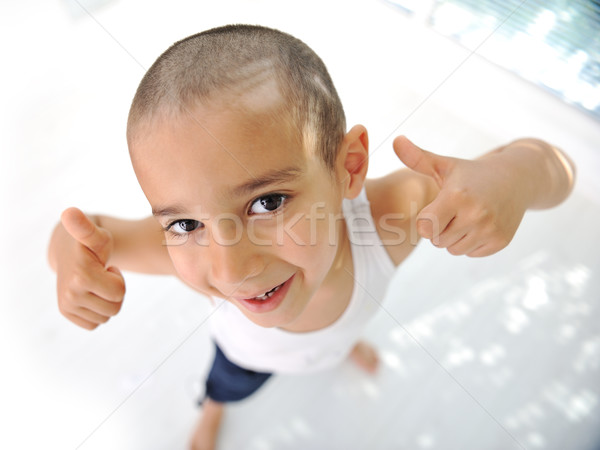 Thumbs up! Little boy, cute short hair, almost bald :) Stock photo © zurijeta