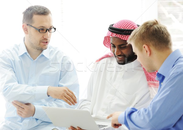 Multicultural different ethnic group working on laptop together Stock photo © zurijeta