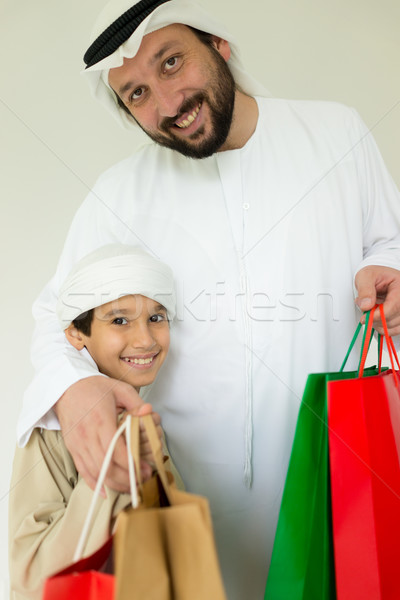 Happy Arabic father and son having fun time with shopping bags Stock photo © zurijeta
