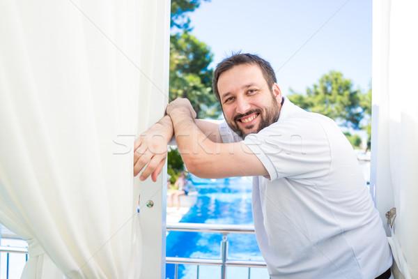 Stockfoto: Man · ontspannen · zomervakantie · luxe · resort · glimlach