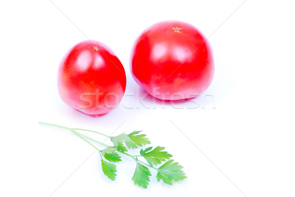 Two pieces of tomato and green lief of parsley Stock photo © zurijeta