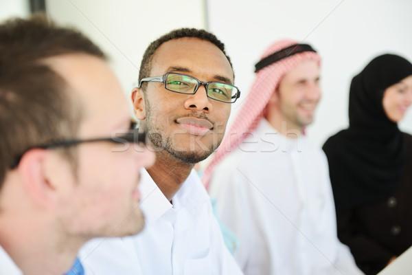 Group of multi ethnic business people at work Stock photo © zurijeta